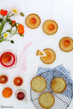 Blood orange tarts with candied orange slices