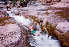Slide Rock State Park, Sedona, AZ. A fun summertime experience with the kids.  But, be careful, those rocks are REALLY slippery!