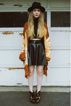 Love the black leather skirt styled up with the brown kimono jacket type thing x