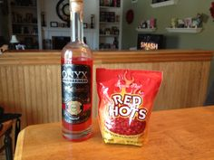 Onyx Moonshine Red Hot infusion!  Use Onyx 111 for this one, it will turn out best.  Fill a sealable jar (or empty Onyx bottle) with 20-30 red hots. Since the alcohol content is quite high and the candy is all sugar, it won't take long to get great flavor.