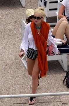 Lindsay Lohan wearing Dsquared Dq 0017 Sunglasses and Prada Saffiano Mini Bag.