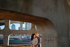 Couple pose in each other's arms in uptown Charlotte NC