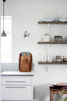 repurposed shelves in the kitchen and different shaped cutting boards