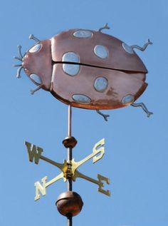 Ladybug Weather Vane by West Coast Weather Vanes.  This whimsical Ladybug weathervane is a perfect complement to a flower, herb or vegetable garden, potting shed, gazebo or simply a home where gardening is a passion. You can choose either Gold Leafed or Palladium Leafed spots for your weathervane (included in the price). We can also do the legs and antennae in copper, brass, nickel silver, palladium or gold leaf depending on your preference.
