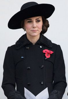 Duchess Kate looked elegant in a black Diane von Furstenberg coat and dress as she observed Remembrance Sunday with Prince William and the royal family in London — photos