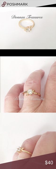 🎄1/2 Carat AAA CZ Engagement Ring This simple ring is a 1/2 Carat AAA CZ in a 14K Yellow Gold Filled setting. On each side is a slight downward swirl to give it a little extra style. #0836-1 Jewelry Rings