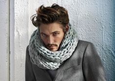 Scarf that looks like ropes of straw. The pastel color softens the masculinity of the suit jacket.