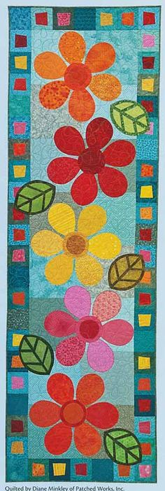 table runner - reminds me of the 60's or 70's (flower power)