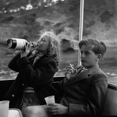 This might be another photo by Mary Ellen Mark. Yvonne (13) and Alexander Sayn-Wittgenstein-Sayn (12) enjoy a drink and smoke aboard a yacht near Majorca