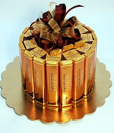 Your Godiva Belgian Gold Candy Bar Cake Will Make A Perfect Gift for Any Occasion. A 9-inch Cake form is Covered with 20 Delicious Godiva Chocolate and Chocolate Almond Bars. Sure to Delight Anyone Who Receives this Exceptional Quality Gift.