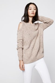 Page Sweater - Set yourself apart in this shoulder-baring sweater. The bold cutouts add a sexy touch to this seasonal staple.