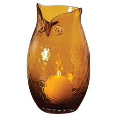 Amber glass owl vase with honeycomb detailing.  Product: VaseConstruction Material: GlassColor: ...
