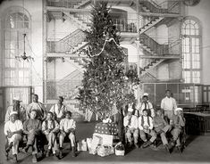 "December 1919. ""Christmas tree at the District Jail, Washington, D.C., and some of the prisoners."" National Photo Co. Collection glass negat..."