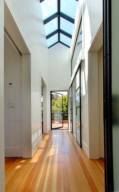 Steel-Framed Skylight in this Upper Level Hallway by Jeff King & Company