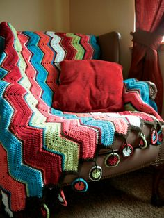zig zag crocheted afghan with whimsical medallion edging