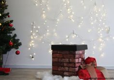 How to set up a cute Christmas Photo shoot at home! Includes the DIY instructions to make the cute Chimney!
