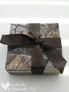 Realtree Camo Coasters.. I could make that too! Blank tiles and Camo adhesive, OR camo paper Modge Podged onto the tiles.