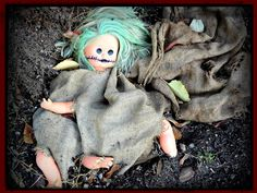 Decoration. Scary Doll Decoration Ideas Featuring Chucky Doll Made From A Girl Baby Doll, Brown Burlap Sacks In Waeving As Well As Green Pol...