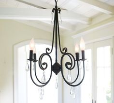 If I ever take down the mason jars above the dining room table, I'm putting this up. I love the mix of rustic and glam in this chandelier.