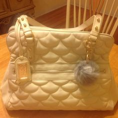 Cream Badgley Mischka quilted leather handbag This is a beautiful pre-owned Ariel handbag by Badgley Mischka. It features buttery soft quilted cream colored leather with a kiss lock inside. The bag is in fair pre-owned condition. There are scuffs, indentations to the leather and some soiling inside but most likely spots can be spot cleaned. The light color allows wear to be seen easily. Still, this is a gorgeous, well-made, quality bag with lots of life left. Badgley Mischka Bags Satchels