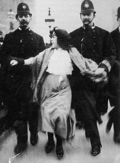 U.K. Sixteen-year-old suffragette Dora Thewlis is arrested by two policemen on 20 March 1907