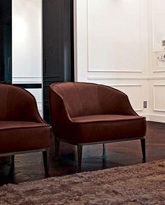 Dark red armchairs |