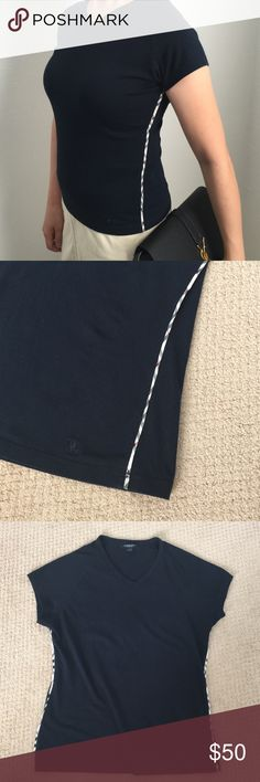 Burberry London v neck crew t-shirt Burberry London v neck crew t shirt. Checkers on both sides. Logo on bottom left. Black color. Size 2. Slim fit. Stretchable. Excellent condition like new. Burberry Tops Tees - Short Sleeve