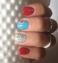 Pretty nail art mani with accent gemstones!