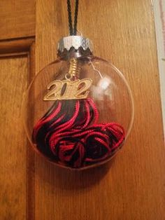 Instead of leaving it in the closet and never looking at it, put your tassel from graduation inside a Christmas ornament and hang it on the tree! Licia Brooke Creations: Lots of random stuff!!
