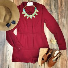 """Would you dress it up for GNO or dress it down for an everyday chic look?  """"Button Romper Burgundy"""" ($38.99 also available in black) in store at #sophieandtrey. Accessorized with """"Cairo Bib Necklace"""" ($29.99) """"Leather Cross Wedge Cognac"""" ($29.99) both in store at #statements. ALL featured items available online at www.sophieandtrey.com #getthelook #ootd #ootn #romper #spring #outfitinspo"""