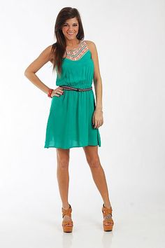 """The Monty Dress, Green $42.00 This dress is to die for! The green color is gorgeous, and we love the embroidered details at the top... such a big trend this season. The gathered waist makes for a flattering fit and it comes with this thin embroidered belt for added detail!   Fits true to size. Miranda is wearing a small.   From shoulder to hem:  Small - 34""""  Medium - 34.5""""  Large - 35"""""""
