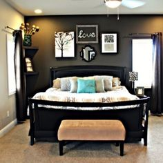 A simple and beautiful way to decorate a master bedroom using unique wall art and bold dark colors.
