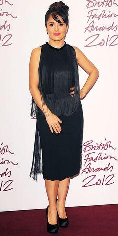 Salma Hayek Pinault  feted the British Fashion Awards in a fringed Stella McCartney LBD, diamond jewels and satin pumps.