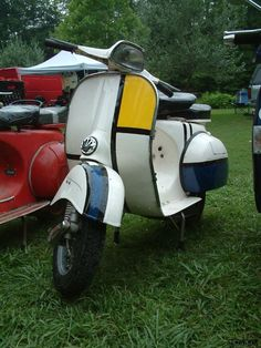 My 1964 Vespa GL with Mondrian themed paint job. A good lesson in how much I hate bodywork and painting. Summer 2006.