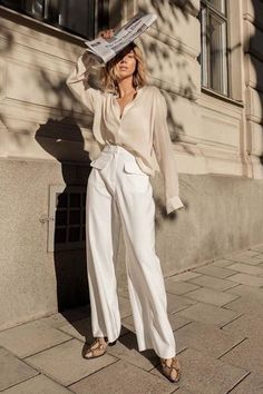 White oversized shirt paired with wide leg pants and snake print boots #shirt #springstyle
