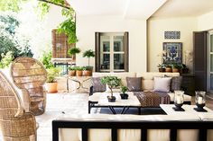A mix of traditional and modern styles, chic fabrics, and gorgeous accessories make for one ideal home designed by Isabel López-Quesada. | Patio with a mix of seating styles