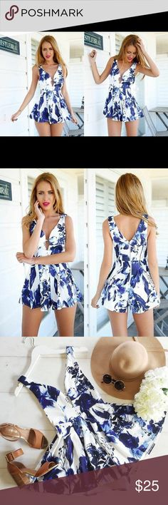 Floral white Royal blue keyhole romper 9/10 L XL This one of a kind short jumpsuit is a perfect addition to your wardrobe for this summer weather. Features a tank top style sleeve, keyhole front, flare out A-line style shorts, rear zip closure. Marked size XL fits up to a 10-12. Brand new. Firm price unless bundled/ no offers Pants Jumpsuits & Rompers
