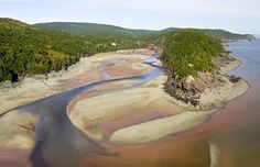 The world's highest tides await visitors at Fundy National Park. Kayak on the Bay of Fundy, explore the seafloor when the tide recedes, hike or bike through native Acadian forests and more at one of Canada's best-known national parks. Best Places To Camp, Places To Visit, East Coast Canada, New Brunswick, Discover Canada, Atlantic Canada, Parks Canada, Camping Spots, Vacation