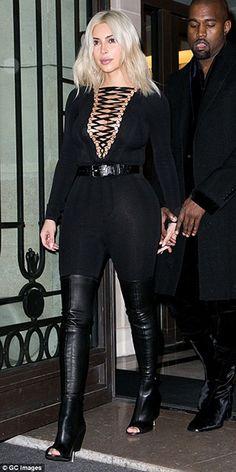 Kim Kardashian at Givenchy fashion show in Paris, France (March 8, 2015) wearing a Givenchy Bodysuit and Givenchy Nunka Stretch Nappa Boots. #kimkardashian #style