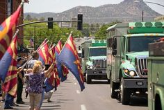 The Granite Mountain Hotshots' vehicles drive through downtown Prescott on July 3, 2013, in a procession from the site of the Yarnell Hill Fire.