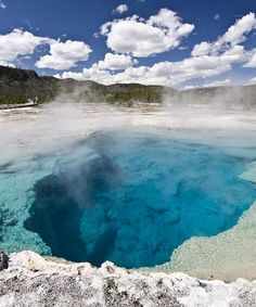 Yellowstone National Park: the world's largest concentration of geysers, the largest lake above 7,000 ft in North America, the largest concentration of mammals in the lower 48 states. The park encompasses parts of Wyoming, Montana, and Idaho, USA.