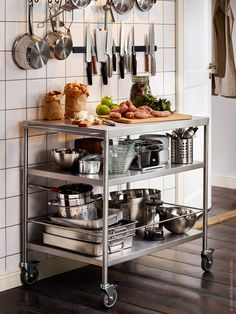A rolling cart like this to serve as storage and a hot water center without having to come all the way into the kitchen and get in the way of prep going on.