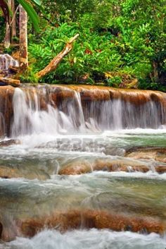 Ocho Rios Dunns River Falls, Jamaica. My husband lost his wedding ring in the Falls during our climb, but the guides found it.