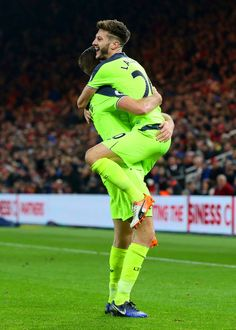 Adam Lallana (R) of Liverpool celebrates scoring his sides third goal with Jordan Henderson (L) during the Premier League match between Middlesbrough and Liverpool at Riverside Stadium on December 14, 2016 in Middlesbrough, England.