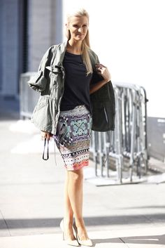 The Street-Style Highlights From Fashion Week Spring '13 : Rework a statement skirt with a slouchy t-shirt and a military jacket.  Source: Greg Kessler