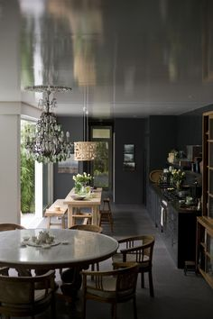 The black kitchen is extremely sophisticated - FINANCIAL MARKETS AND THE FRANGIPANI TREE | the generalist