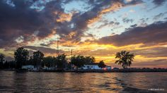 Sunset Through the Coast Guard Station at Sodus Point, NY - by Mikell Herrick