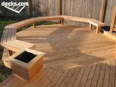 Professional Deck Builders Inc. this opens up the view into the yard by using bench seating in place of railings