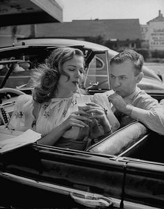 A couple at a drive-in for cold drinks. Los Angeles, 1945//