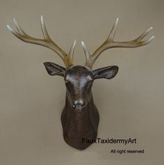 Antique bronze Faux Deer Head resin deer head, wall decor, wall hanging, faux taxidermy, deer home decor, wall hanging, wall art faux animal by FauxTaxidermyArt on Etsy https://www.etsy.com/listing/189032693/antique-bronze-faux-deer-head-resin-deer